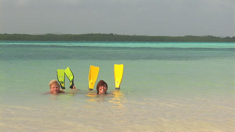 Mother and daughter playing in ocean Stock Video Footage