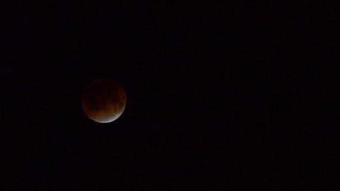 Total moon eclipse when the moon appears to be red Stock Video Footage