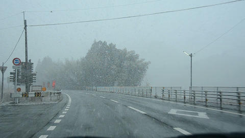 Driving through heavy snow fall in Japan Footage