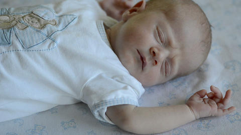 Cute baby sleeping and dreaming, seen from above Footage