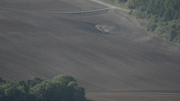 Tractor tilling soil in autumn after harvest Stock Video Footage