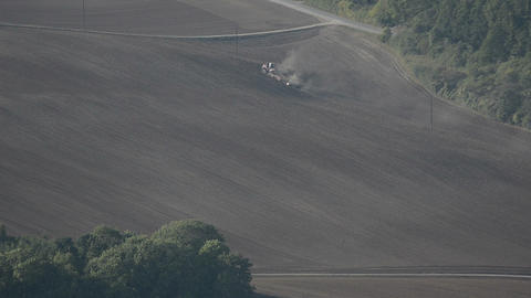 Tractor tilling soil in autumn after harvest Footage