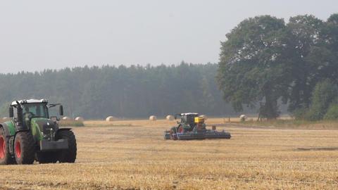 Tractor on farm field Stock Video Footage