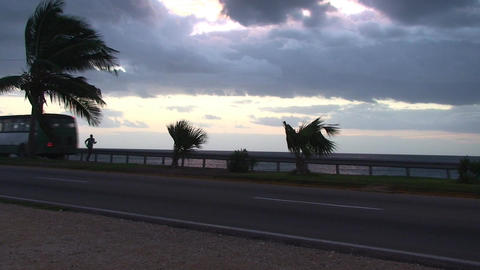 Cuba Sunrise street with cars runner and bicycle Stock Video Footage