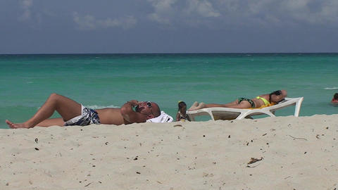 Varadero man and women at the beach child playing Stock Video Footage