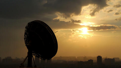 rotating radio telescope at sunset Stock Video Footage