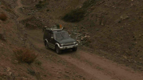 Car driving in Wakhan Valley Rain Tajikistan & Afg Stock Video Footage