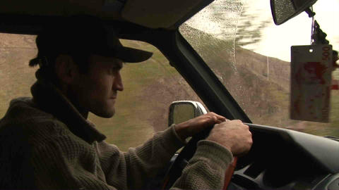 Guy driving in Wakhan Valley Rain Tajikistan Stock Video Footage