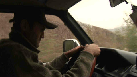 Guy driving in Wakhan Valley Rain Tajikistan Stock Video Footage