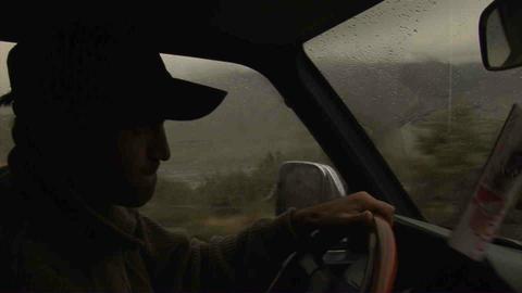 Guy driving in Wakhan Valley Rain Tajikistan 3 Stock Video Footage