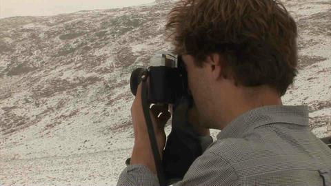 Guy taking picture Analogue Snow Tajikistan Stock Video Footage