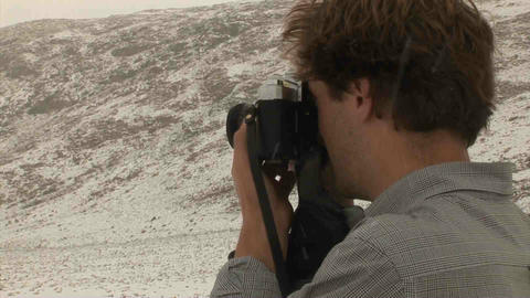 Guy taking picture Analogue Snow Tajikistan Stock Video Footage