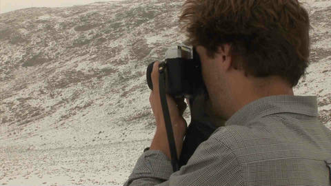 Guy Taking Picture Analogue Snow Tajikistan stock footage
