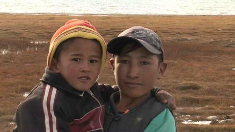 Kids pose for camera Karakul Lake Tajikistan Stock Video Footage
