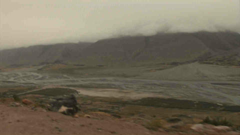 View on Afghanistan Driving in Wakhan Valley Rain Stock Video Footage