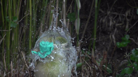Bursting balloon with water slowmotion 400fps Stock Video Footage