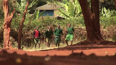 Kids dancing on dusty road Stock Video Footage