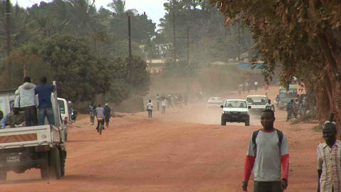 Dusty Road, people walking by, Mozambique Footage