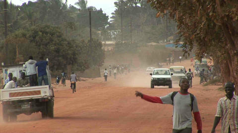 Dusty Road, people walking by, Mozambique Stock Video Footage