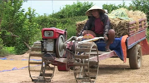 Agricultural machinery passing by Stock Video Footage