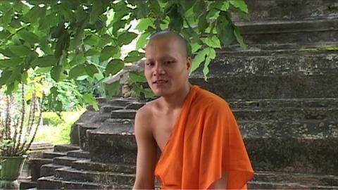 Wat Si Saket temple, monk smiling Footage
