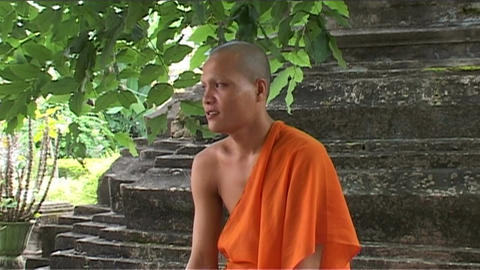 Wat Si Saket temple, monk smiling Stock Video Footage
