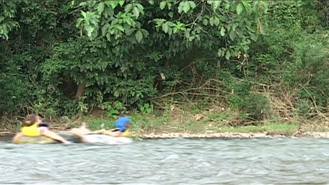 Inner tubing on the Nam Xong river Stock Video Footage