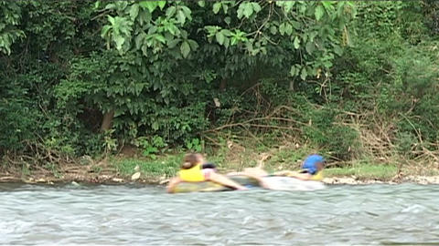 Inner tubing on the Nam Xong river Footage