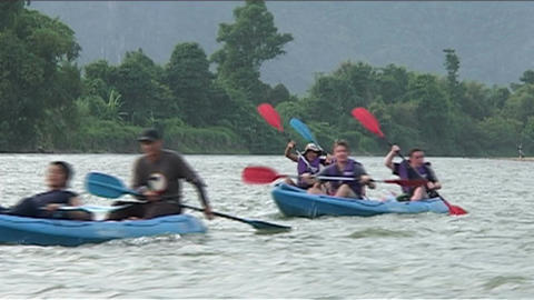 Canoeing on the river Nam Xong Stock Video Footage