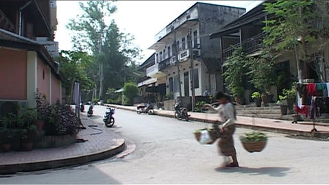 Luang Prabang, woman with baskets Stock Video Footage