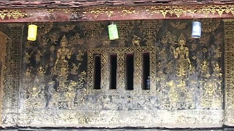 Luang Prabang Wat Xieng Thong temple, wall Stock Video Footage