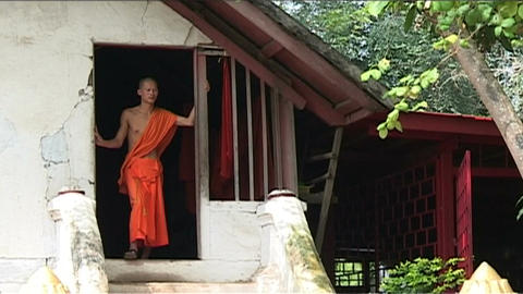 Luang Prabang Wat Xieng Thong temple, monk in door Footage