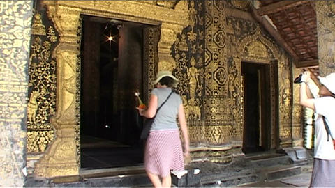 Luang Prabang Wat Xieng Thong temple, tourist walk Stock Video Footage