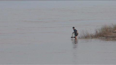 Luang Prabang man trows fishnet Stock Video Footage