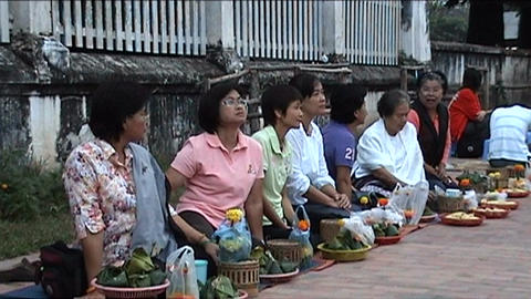 Luang Prabang, monks on alms-round Stock Video Footage