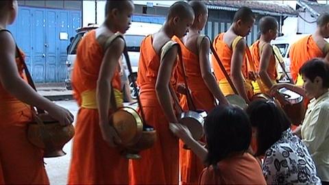 Luang Prabang, monks on alms-round Footage
