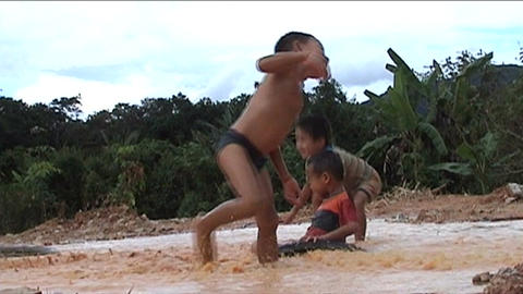 Children playing in water Stock Video Footage