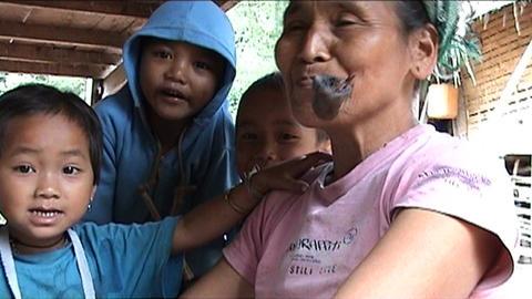 Ban Nalan Khamu woman with pipe Stock Video Footage