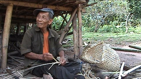 Khmu man makes fish baskets Stock Video Footage