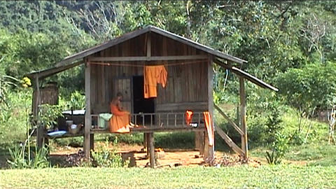 Monk on porch of house Stock Video Footage