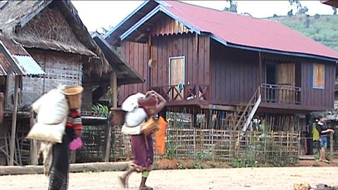 Phoukha woman with rice bags Stock Video Footage
