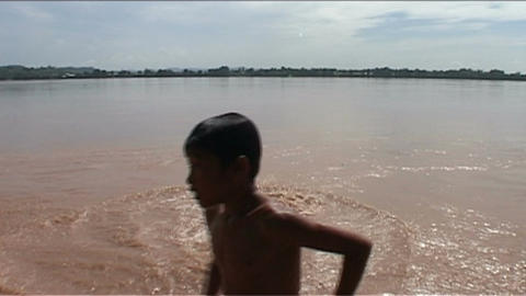 Boy jumps in to the water Stock Video Footage
