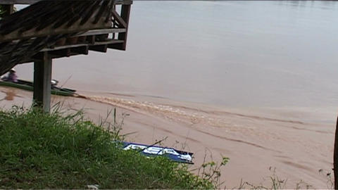 Longboat passing by on Mekong Stock Video Footage
