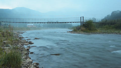 Morning fog in the mountains and the bridge over t Stock Video Footage