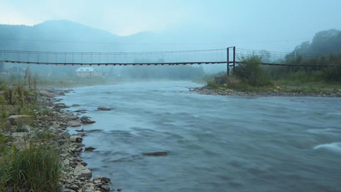 Morning fog in the mountains and the bridge over t Footage