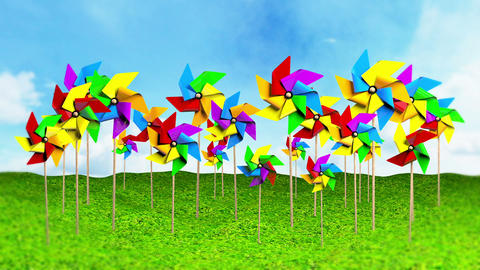 Colored Spinning Pinwheels On The Grass stock footage