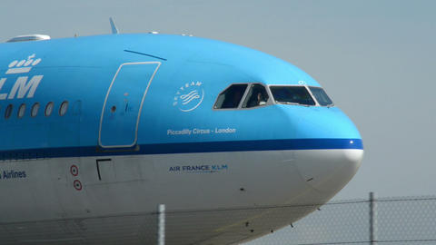 KLM airplane on taxiway pilot winking 11016 Stock Video Footage