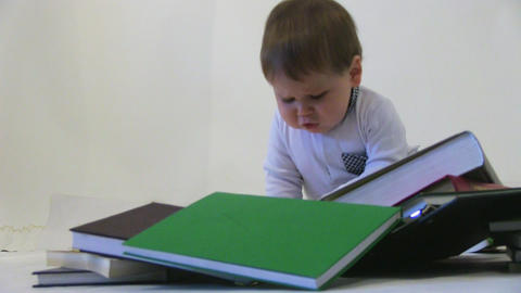 Little baby among books Stock Video Footage