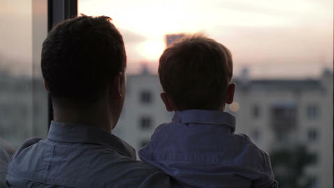 Happy father with his little son near the window Stock Video Footage