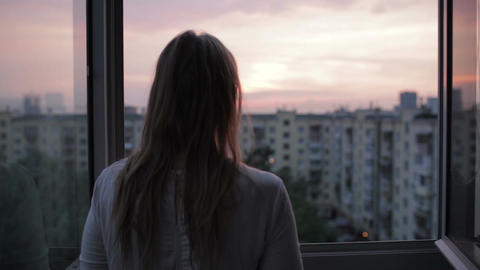 Young couple on the balcony at sunset Stock Video Footage